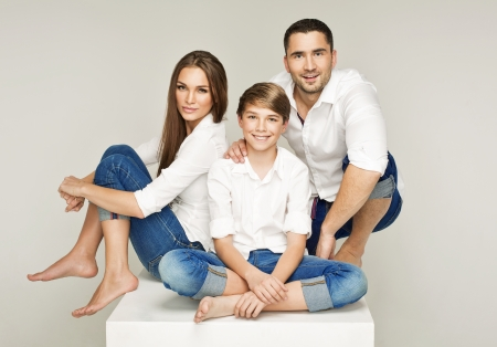 Happy young family with pretty child photo