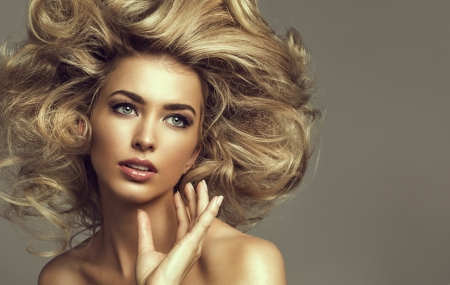 Portrait of a young blond woman with beautiful hair and green eyes photo