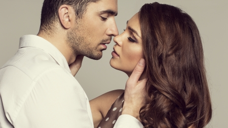 Portrait of romantic couple touching and kissing each other photo