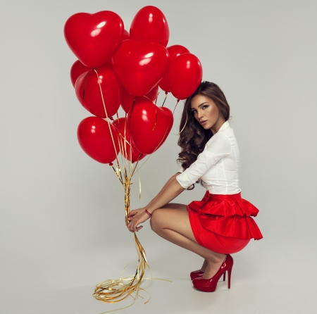 Sexy brunette with balloons heart Stock Photo