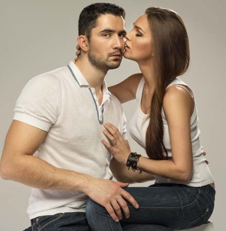 Beautiful woman kissing handsome man photo