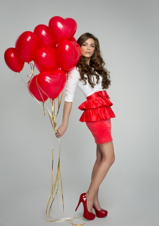 Beautiful woman with red balloon Stock Photo - 25528516
