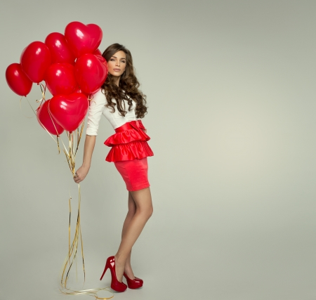 Beautiful woman with red balloon heart shape for valentine Stock Photo - 25528481