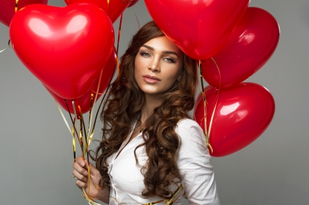Portrait of woman with red balloon heart shape for valentine Stock Photo - 25528522
