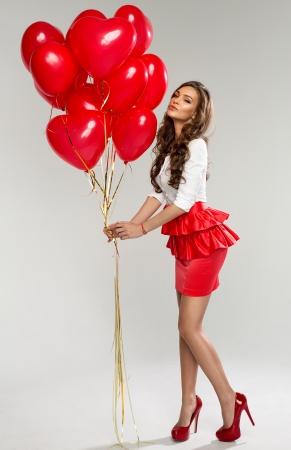 Beautiful young woman with red balloon heart shape for valentine Stock Photo - 25528483