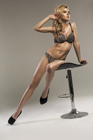 Blond woman with perfect body photo