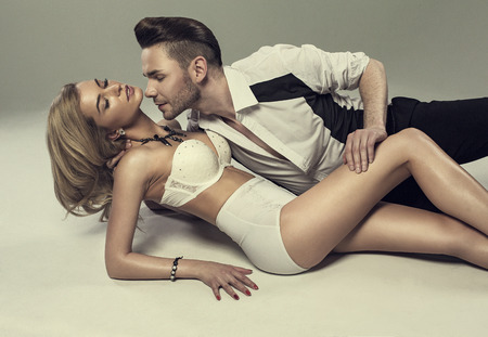 topless: Fashion portrait of beautiful young lovers