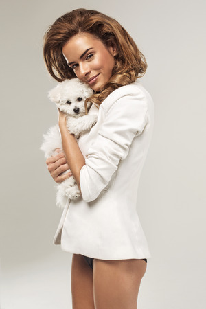 Beautiful woman with a dog photo