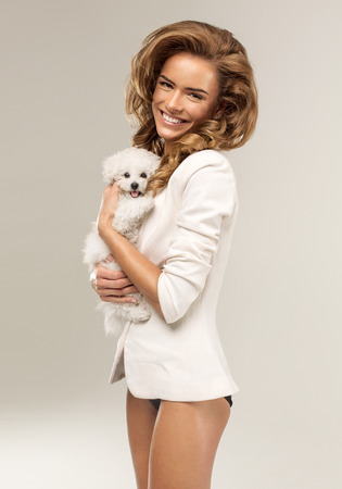 Smiling woman with a puppy photo