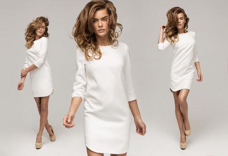 Три сексуальная женщина в белом платье Фото со стока