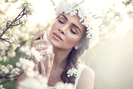 Beautiful sensual woman applying perfume Stock Photo
