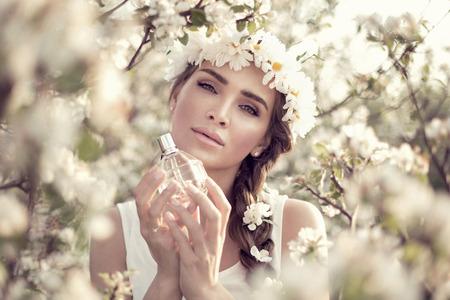 perfume spray: Beautiful woman with perfume bottle Stock Photo