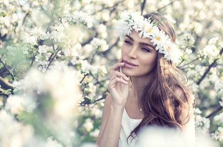 Sensual woman with wreath on head photo