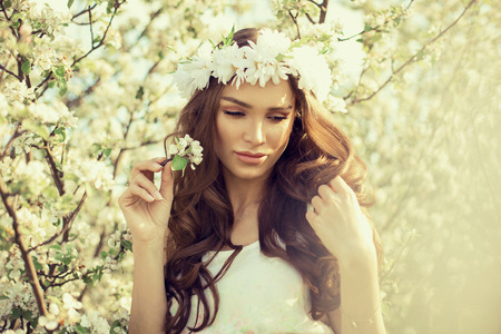Sensual woman in the garden of apple photo