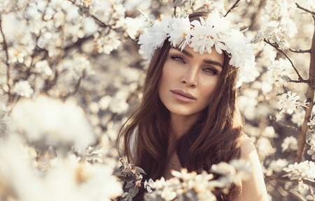 Sensual woman in the garden of flowers photo