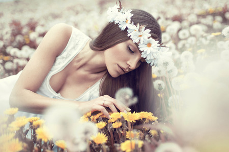 Portrait of beautiful woman on dandelions meadow  Stock Photo - 29379915