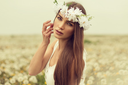 Portrait of young woman on a meadow Stock Photo - 29379920