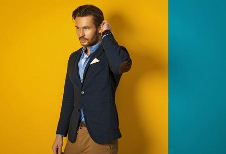 good looking model: Fashionable man wearing jacket and posing Stock Photo