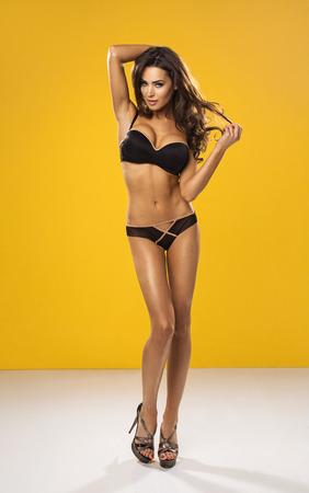 sexy woman lingerie: Sexy unusual woman wearing swimwear on orange background