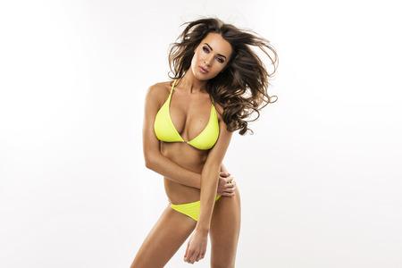 emotive: Emotive portrait of sexy woman in yellow swimwear Stock Photo