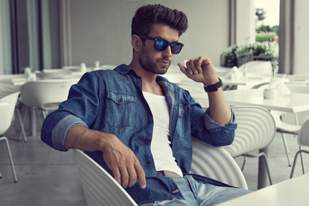 Sexy man in sunglasses photo