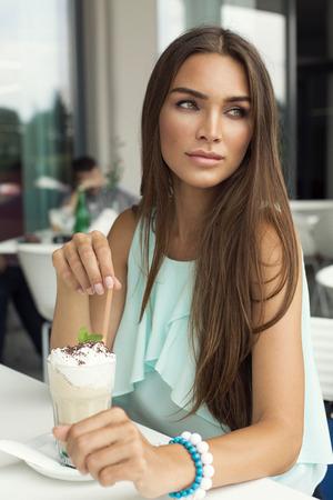 Beautiful woman in cafe photo