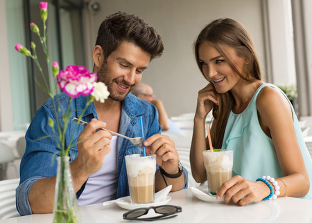 shy woman: Portrait of a happy couple in restaurant