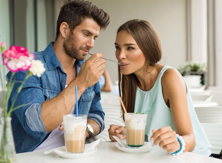 Two friends drinking coffee photo