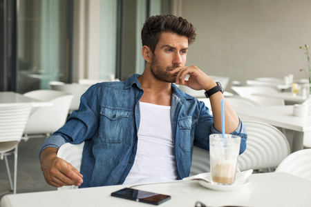 Young handsome man in cafe photo