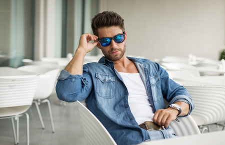 Young handsome man in sunglasses photo