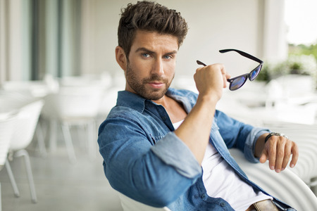 men shirt: Young handsome man in sunglasses