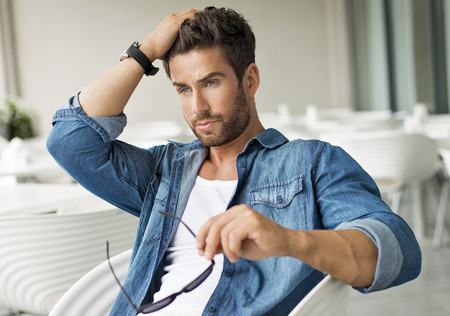 Handsome man touching his hair Stockfoto