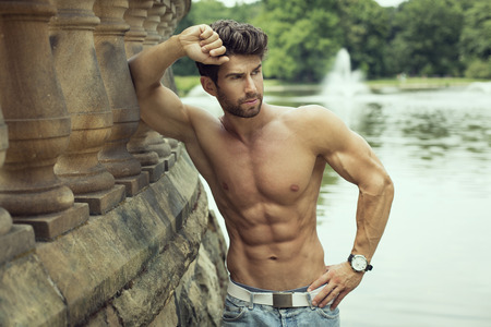 Handsome muscular man outdoor photo