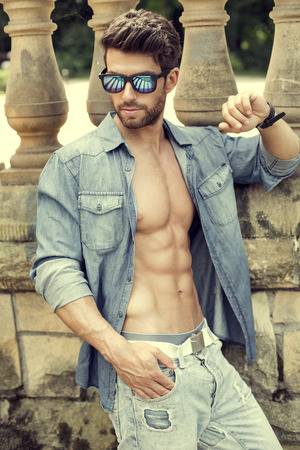 Handsome man wearing sunglasses photo