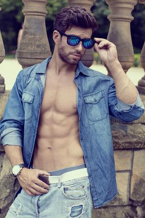 romantic sexy: Handsome man wearing sunglasses