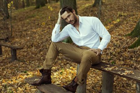 shoe model: Fashion model posing in autumn scenery