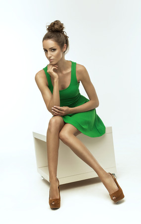 green clothes: Beautiful woman in green dress Stock Photo