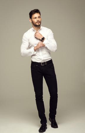 handsome: Handsome elegant man buttoning shirt Stock Photo