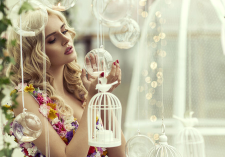 Glamour portrait of blond woman with baubles photo