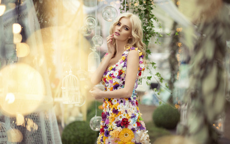 flowers bokeh: Beautiful woman in dress of flowers