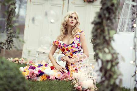fairy garden: Beautiful blond woman in a dress of flowers Stock Photo
