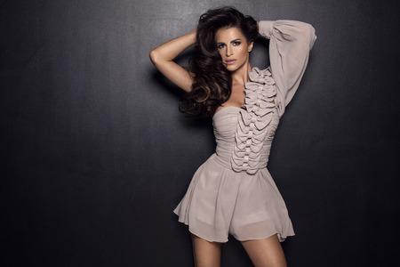 Brunette woman posing in fashion dress