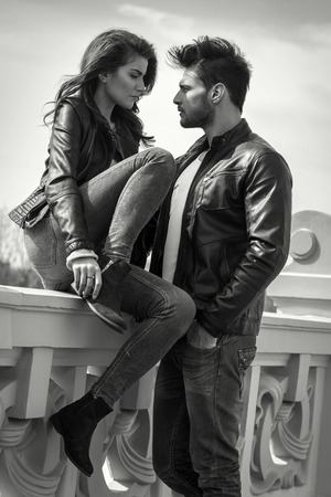 Black and white photo of young fashionable couple