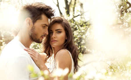 emotional couple: Summer photo of beautiful young couple in the garden Stock Photo