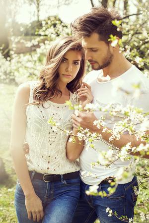 Portrait of beautiful couple walking in the garden Stock Photo