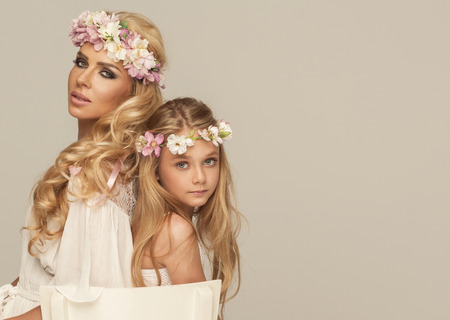 Beautiful mother and doughter with wreath