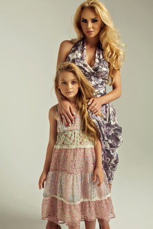 fashion photo of beautiful mother and daughter Stock Photo