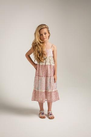 preteen model: Full length portrait of a little girl in long dress