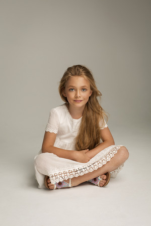 little blonde girl: Beautiful little girl sitting