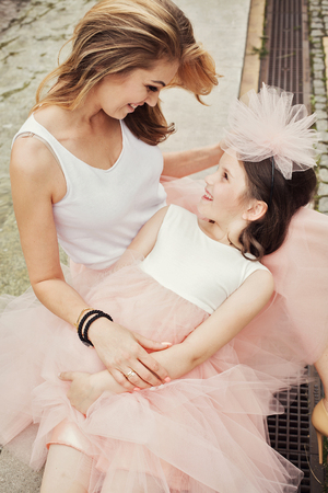 same: Mother and daughter in same outfits weared tutu skirts
